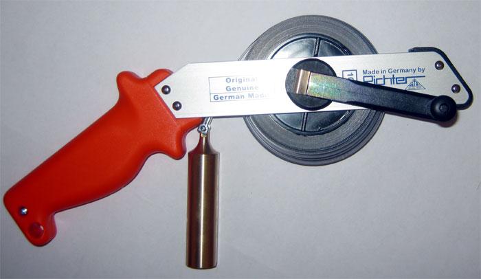 измерительной рулеткой
